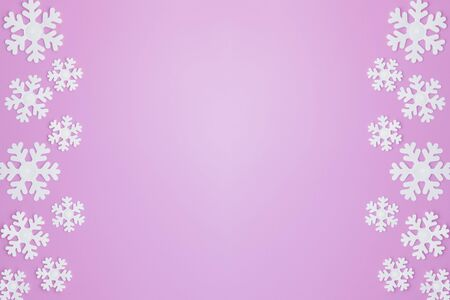 Winter pattern made of snowflakes and on pink background. Christmas concept. Flat lay. Copy space for your text