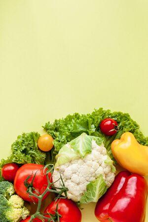 Healthy Eating. Seasonal organic raw vegetables on yellow background. 스톡 콘텐츠
