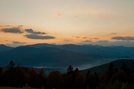 Sunset over the mountains in Ukraine, raising sun beams illuminating an mountainside. Stock fotó
