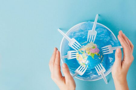 Globe on a plastic plate. The concept of ecology, land conservation.