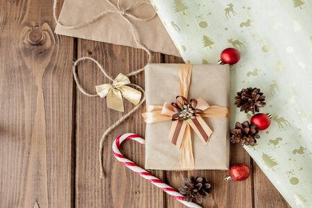 Christmas presents with ribbon on dark wooden background in vintage style.