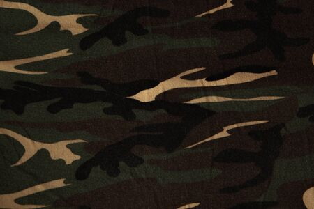 Closeup of military uniform surface. Texture of fabric, close-up, military coloring. 스톡 콘텐츠