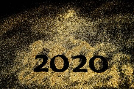 Happy New Year 2020. Creative Collage of numbers two and zero made up the year 2020. Beautiful sparkling Golden number 2020 on black background for design 스톡 콘텐츠