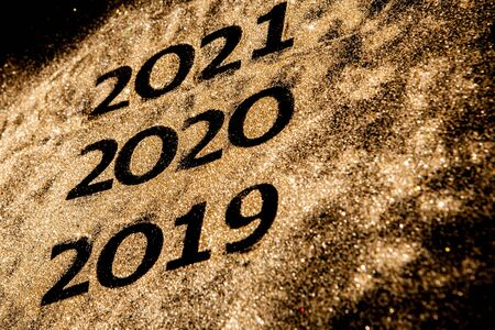Beautiful sparkling Golden Numbers of 2019 to 2020 on black background for design, happy new year concept. 스톡 콘텐츠