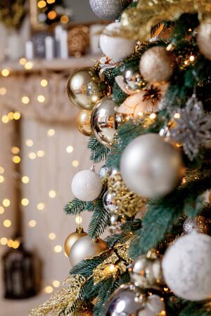 Decorated Christmas tree on blurred, sparkling and fairy background. 스톡 콘텐츠