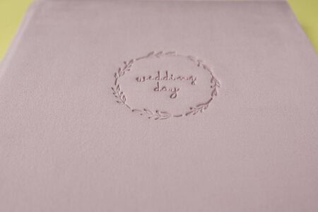 Inscription WEDDING DAY supplanted on velour wedding book. 스톡 콘텐츠