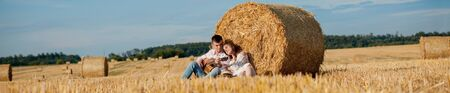 Happy young couple on straw, romantic people concept, beautiful landscape, summer season