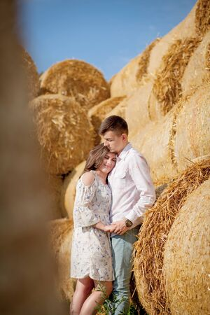 Happy young couple on straw, romantic people concept, beautiful landscape, summer season. Imagens