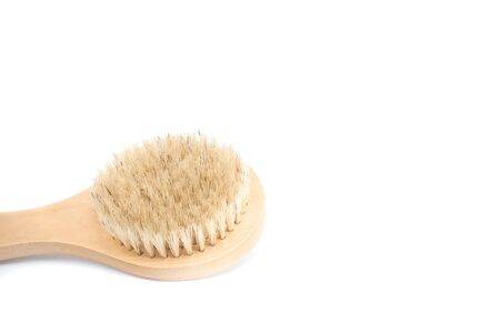 Closeup of cactus fiber body brush isolated on a white background. Natural, plastic free beauty tool. Bath and home self care concept. Flat lay, top view. Copy space for your text.