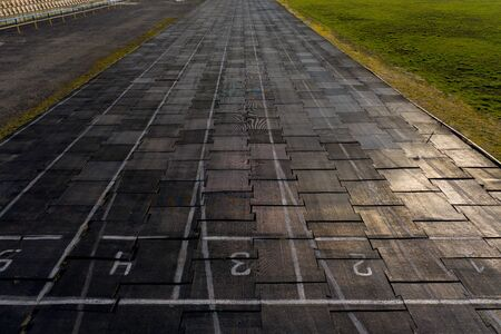 Running track texture with lane numbers, Running track background.