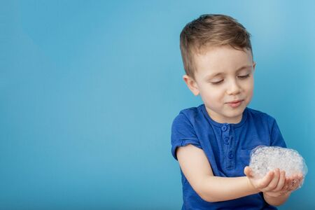Child showing his hands with soap lather, cleaning and hygiene concept.Cleaning your hands frequently with water and soap will help prevent an epidemic from pandemic virus.