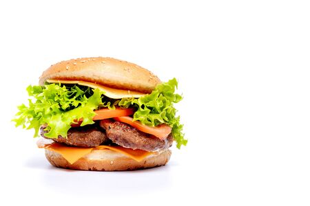 Cheeseburger or hamberger on a white background. Fast food. Banco de Imagens