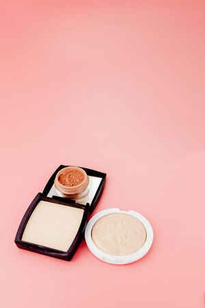 Tonal foundation and highlighter, base for make-up in the form of a cushion. Highlighter powder cosmetic product top view.