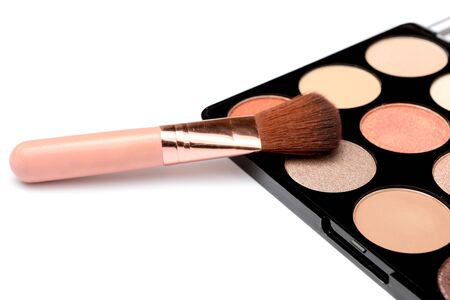 Make-up palette with brushes isolated on white background. top view.