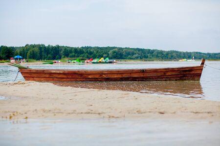 Old fisherman boat at sunrise time on the beach. Reklamní fotografie