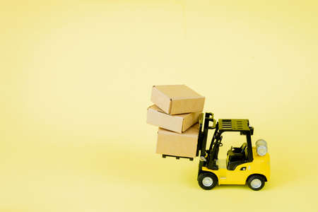 Mini forklift truck load cardboard boxes. Logistics and transportation management ideas and Industry business commercial concept