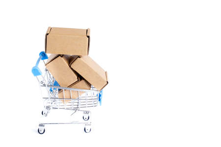 Shopping cart full of cardboard boxes, isolated on white background.