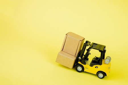 Mini forklift truck load cardboard boxes. Logistics and transportation management ideas and Industry business commercial concept.