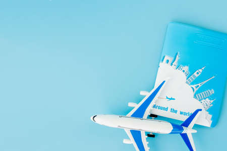 Passport and airplane on light blue background.Summer or vacation concept. Copy space Standard-Bild