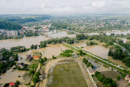 Climate change and the effects of global warming. Flooded village, farms and fields after heavy rains. Environmental natural disaster. Concept of global catastrophes in the world. Archivio Fotografico