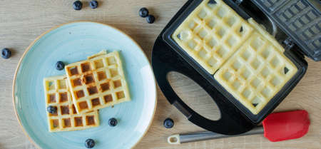 Waffles Being Baked in the Waffle Maker. Savory waffles. Breakfast concept.