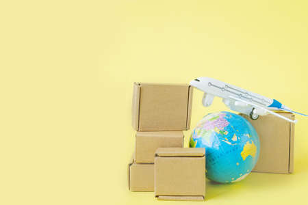 Airplane and stack of cardboard boxes. concept of air cargo and parcels, airmail. Fast delivery of goods and products. Cargo aircraft. Logistics, connection to hard-to-reach places. Banner, copy space.