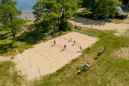 Shatsk- UkraineJuly 25, 2020: Undefined players in action during the Hellenic championship Beach Volley Masters 2020. Aerial shot.