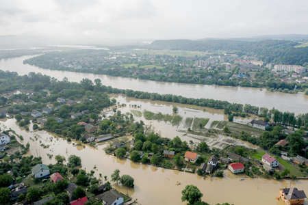 Climate change and the effects of global warming. Flooded village, farms and fields after heavy rains. Environmental natural disaster. Concept of global catastrophes in the world. Banco de Imagens