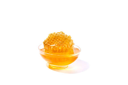 Bowl of honey isolated on white backgroundas package design element. Banque d'images