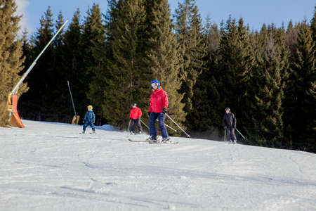 Skiing people and the chair lifts of ski region in Ukraine.