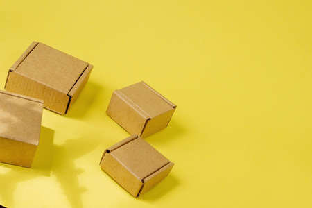 Shadow Airplane and stack of cardboard boxes. concept of air cargo and parcels, airmail. Fast delivery of goods and products. Cargo aircraft. Logistics, connection to hard-to-reach places. Banner, copy space.
