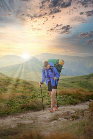 Hiker on the top in Carpathians mountains. Travel sport lifestyle concept. 免版税图像