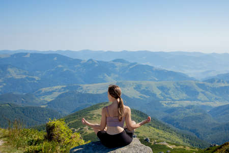 Yoga, Meditation. Woman balanced, practicing meditation and zen energy yoga in mountains. Girl doing fitness exercise sport outdoors in morning. Healthy lifestyle concept