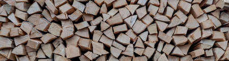 Stacks of Firewood. Preparation of firewood for the winter. Pile of Firewood Firewood background.