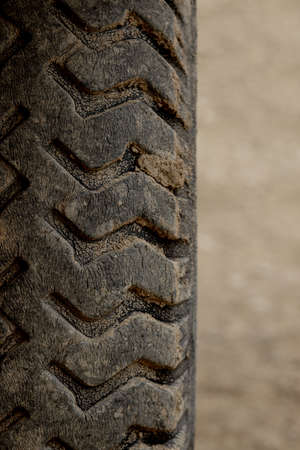 Detail of an old, cracked tractor tire.