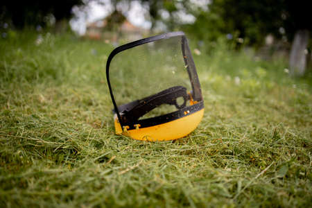 Protective helmet for the mower on cut grass.