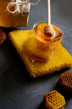 Healthy Thick honey dipping from the wooden honey spoon, bee products by organic natural ingredients concept. Standard-Bild
