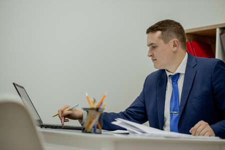 Workplace attorney success collar executive notary broker lawyer people corporate concept. Concentrated serious handsome pensive smart clever broker realtor recruiter using netbook at work. Standard-Bild