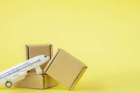 Airplane and stack of cardboard boxes. concept of air cargo and parcels, airmail. Fast delivery of goods and products. Cargo aircraft. Logistics, connection to hard-to-reach places. Banner, copy space