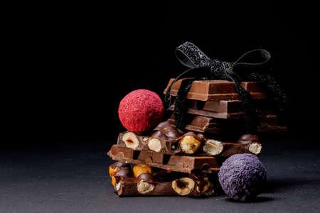 Chocolates background. Chocolate. Assortment of fine chocolates in white, dark, and milk chocolate. Praline Chocolate sweets.