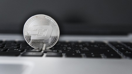 Silver Dash Cryptocurrency on laptop keyboard. Virtual money. Bussiness, commercial. Digital money and virtual crypto currency concept. Investment. Bussiness, commercial. Profit from mining.