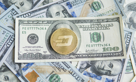 Golden Dash Cryptocurrency coin on a pile of US dollars, cash money and crypto currency concept. Virtual. Metal coins of Dash coin on banknotes of one hundred dollar. Exchange. Bussiness, commercial. 版權商用圖片