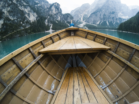 Nose of wooden boat at the alpine mountain lake. Lago di Braies, Dolomites Alps, Italy.