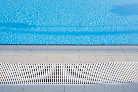 Outdoor sunny swimming pool with a beautiful clean blue water. Stok Fotoğraf