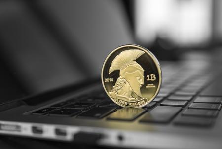 Titan bitcoin coin symbol on laptop.