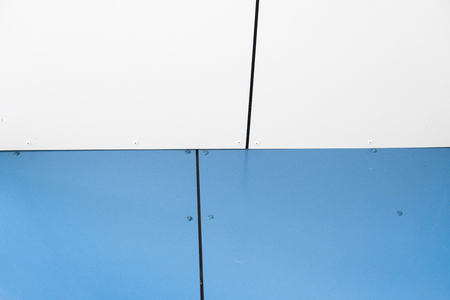 Close up on details of white and blue aluminum facade and aluminum panels. Can be used as a texture or background.