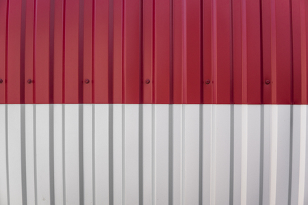 Metal white and red sheet for industrial building and construction. Roof sheet metal or corrugated roofs of factory building or warehouse.