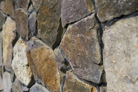 Close-up of surface of natural stone fence. Stone wall as a background. Archivio Fotografico