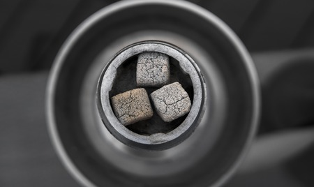 Close-up of a top of hookah with coconut coal.