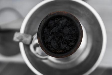 Tobacco for hookah in a clay bowl for shisha smoke.